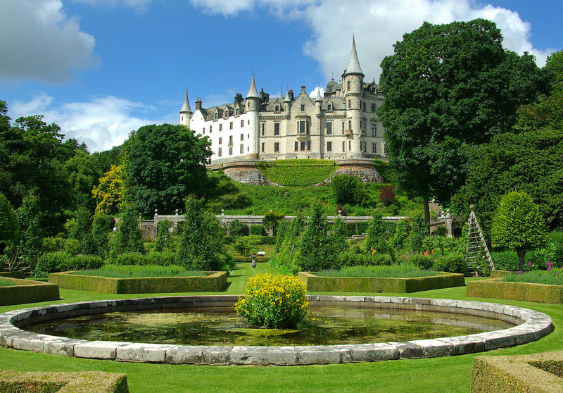 Dunrobin Castle Splendour Ancestral Home Architecture Beauty In Nature Building Exterior Castle Day Dukes Of Sutherland Dunrobin Castle Formal Garden Golspie Grass Green Color Growth Historic Building Nature No People Ornamental Garden Outdoors Plant Scotland Sky Sutherland Topiary Tree Visitor Attraction