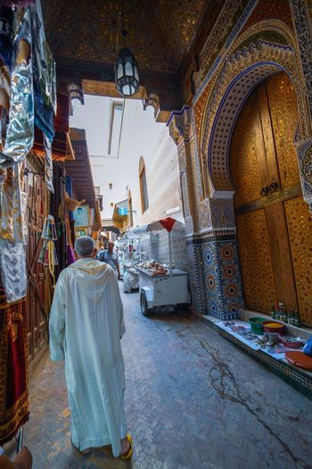 og Travel Destinations Travel Photography Digital Nomad EyeEmNewHere Morocco Fes Morocco Religion Belief Spirituality Architecture Indoors  Rear View Place Of Worship Full Length One Person Day Built Structure Building Adult Real People Praying Clothing Women