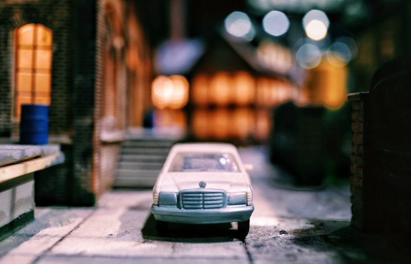 Close-up of vintage car on street at night