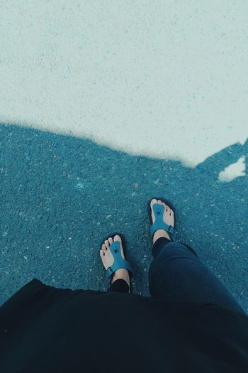 This photo is a photo of my feet and sandals i took directly from my camera