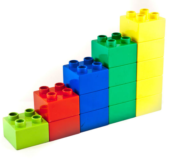 Close-up of colorful toy blocks against white background