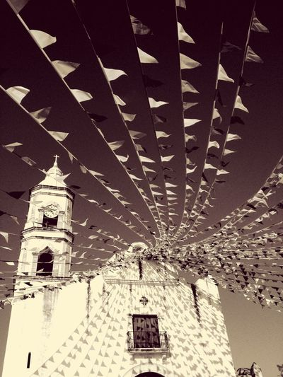 EyeEm Best Shots EyeEmNewHere Lifestyle Photography Lifestyle Travel Photography Travel Destinations Church Tradition Celebration Feria Architecture Religion Place Of Worship Built Structure Spirituality Low Angle View No People Building Exterior Indoors  Hanging Day Sky