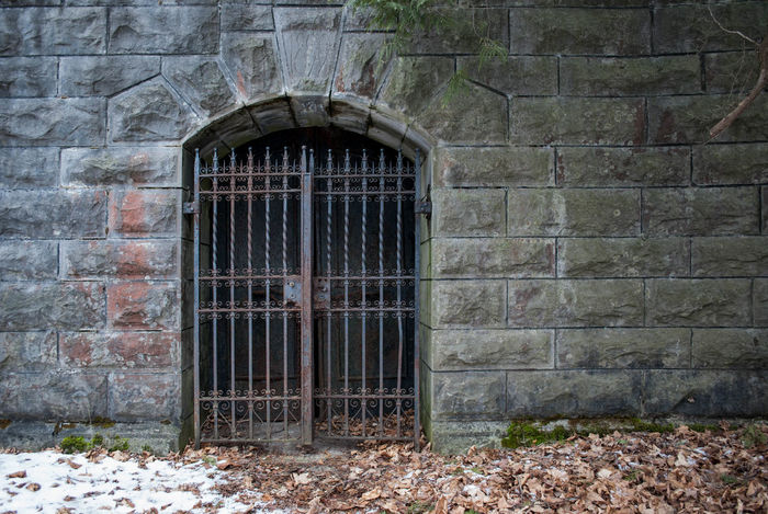 Abandoned Architecture Bad Condition Built Structure Cemetary Crypt Damaged Death Door Exterior Gate Grave Iron Locked Old Outside Ruined Rust Stone Tomb Wall Wrought Iron