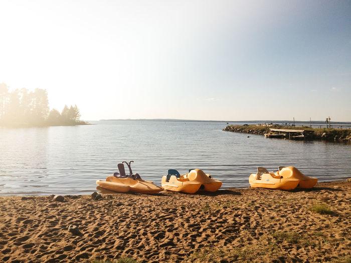 Pedal Boats On Lakeshore