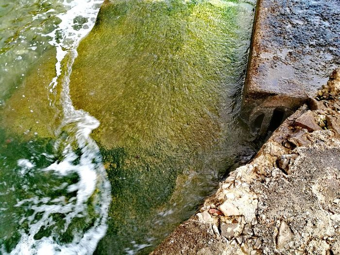 Water Close-up Sea Water Meet The Shore Rocks Green Algee Floor Soft And Fluid Vs. Hard And Fixed