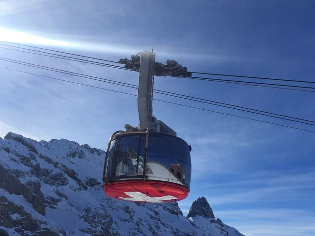 Titlis Rotair Cable Car Cable Car Blue Blue Sky Alps Alps Switzerland Reflection Mountain Mountains Engelberg Titlis Titlis,Switzerland Titlisrotair Rotair Rotating Cable Car Mountain Reflection Cable Swiss Flag Swiss Tourism Ski Holiday Winter Holiday Snow Sun The Great Outdoors - 2018 EyeEm Awards