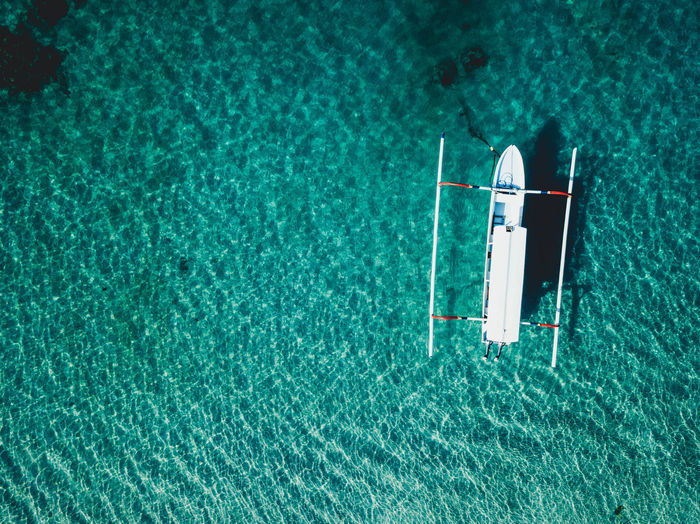 Absence Beauty In Nature Blue Boat Clear Water Day High Angle View Luxury Nature No People Outdoors Rippled Sea Sunlight Swimming Pool Textile Tranquility Transparent Turquoise Colored View From Above Water Waterfront