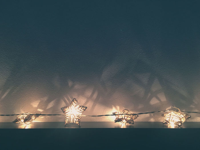 electric light in star shape Illuminated Lighting Equipment No People Electricity  Low Angle View Representation Wall - Building Feature Reflection Christmas Lights Light Decoration Glowing Outdoors Art And Craft Light - Natural Phenomenon Night Electric Lamp