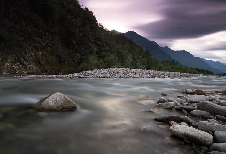 Water Sky Cloud - Sky Beauty In Nature Rock Solid Scenics - Nature Rock - Object Mountain Sea Nature No People Tranquility Tranquil Scene Motion Day Land Beach Long Exposure Outdoors Surface Level Flowing Water Pebble Flowing