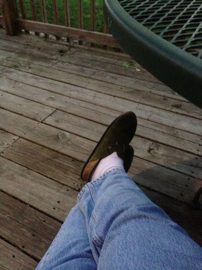 End of day, sitting on the back deck, uploading photos on EyeEm.... Relaxing Shoes Everyday Life Playing With My IPhone 5
