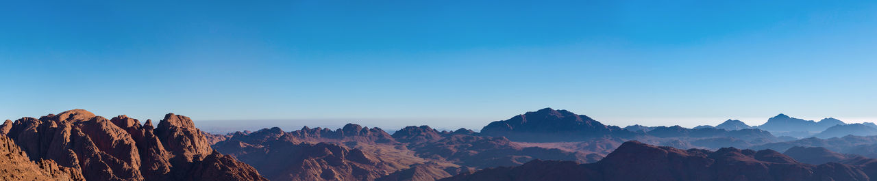 Amazing Sunrise at Sinai Mountain, Beautiful dawn in Egypt, Beautiful view from the mountain. Panorama. Cloudscape Mountain Nature Colorful Desert Egypt High Angle View Hill Israel Landscape Morning Moses Panorama Rock Scenery Sinai Sky Summer Sunrise Top Tourism Travel Africa Beautiful Outdoors
