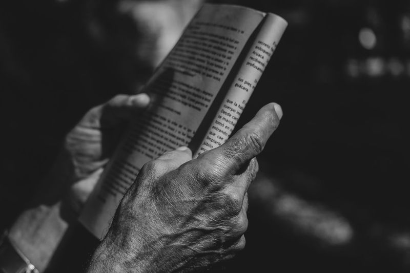 Black And White Reading Human Hand Hand One Person Human Body Part Real People Holding Focus On Foreground Lifestyles Paper Publication Book My Best Photo