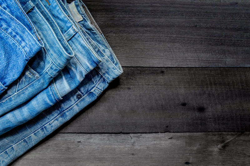 High Angel View Of Blue Jeans On Table