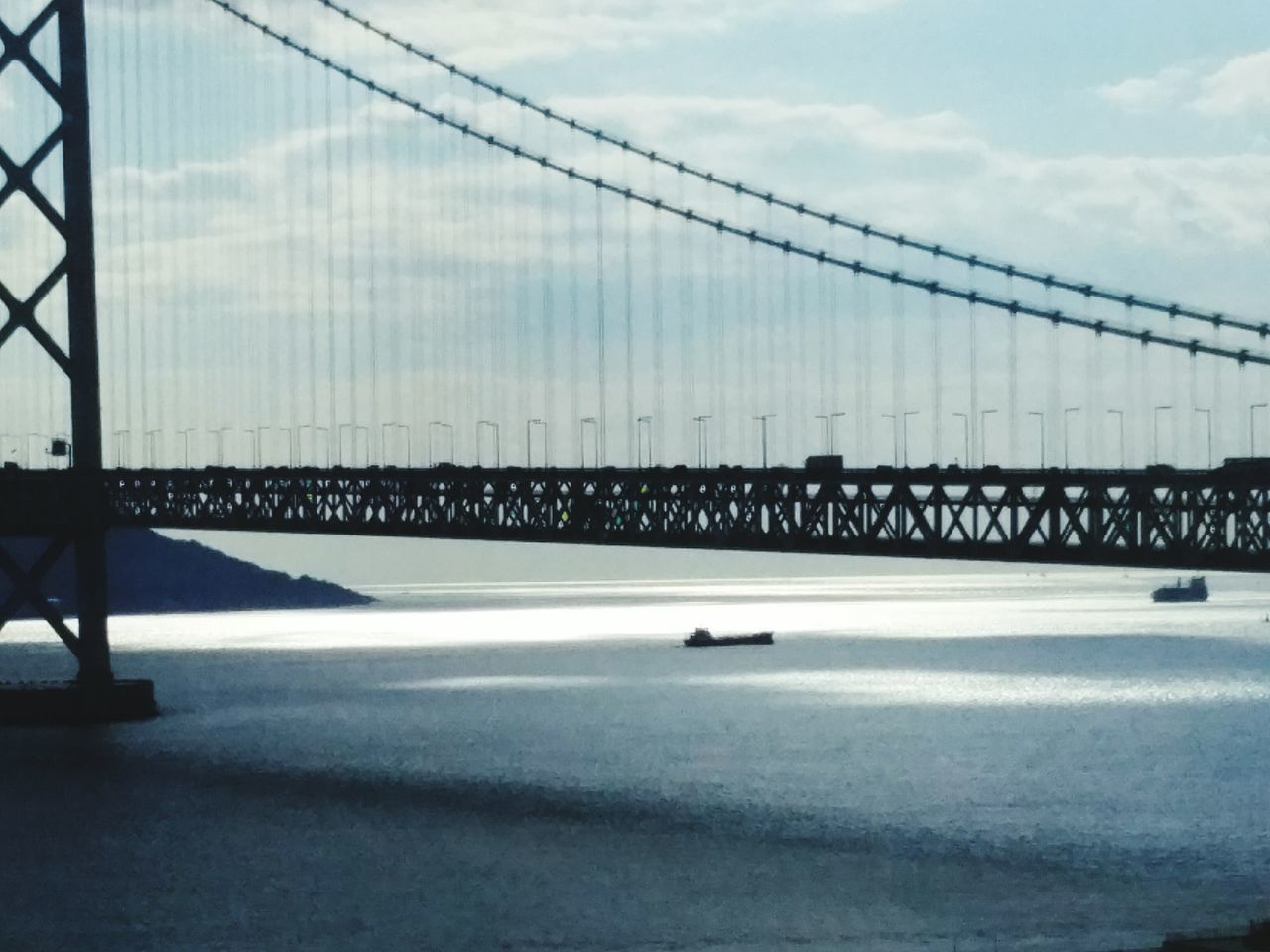 bridge - man made structure, sky, suspension bridge, sea, cloud - sky, connection, outdoors, bridge, architecture, day, no people, transportation, built structure, water, scenics, nature, horizon over water, beauty in nature