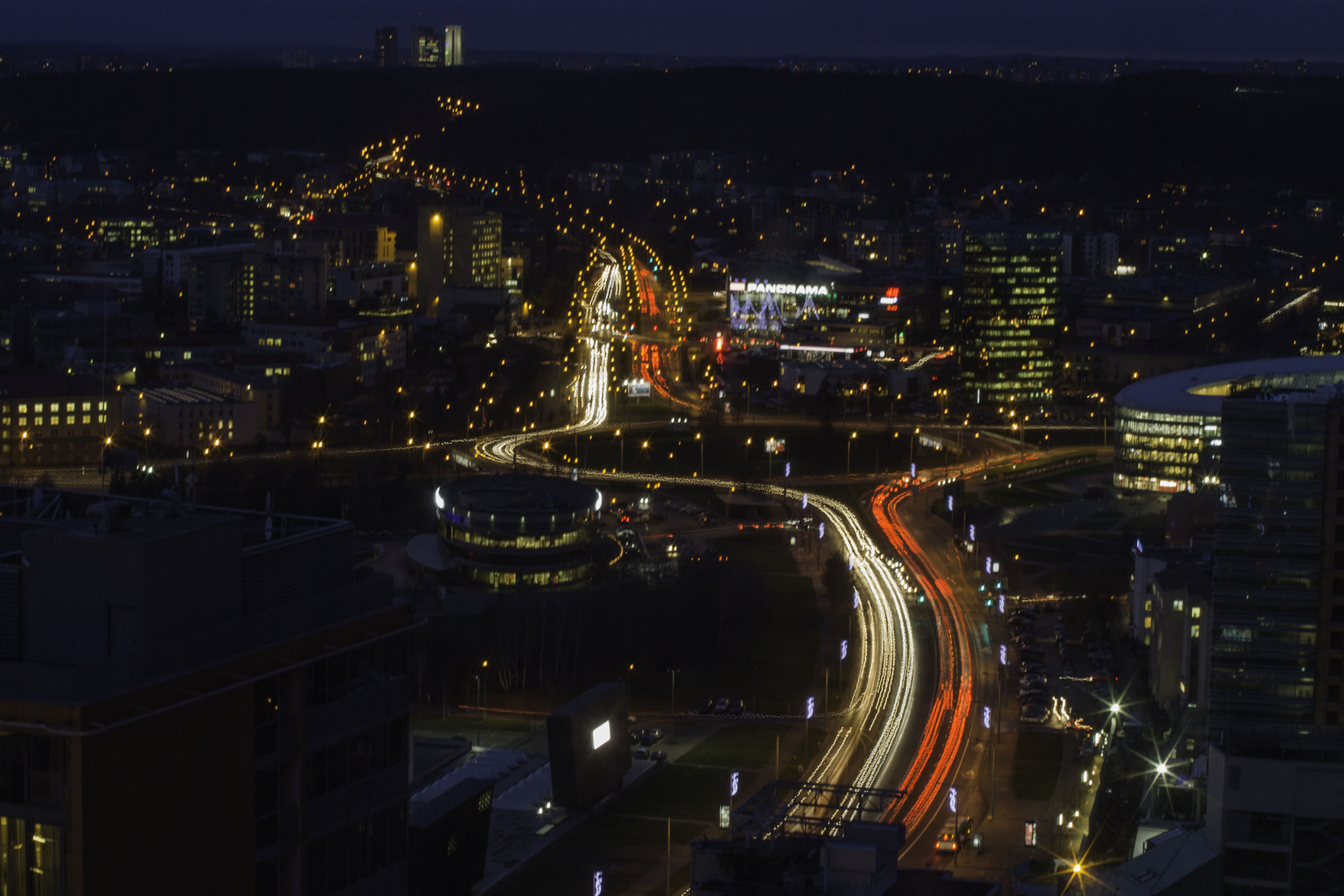 illuminated, city, night, building exterior, cityscape, architecture, built structure, high angle view, skyscraper, crowded, city life, modern, office building, aerial view, residential district, tall - high, tower, residential building, capital cities, outdoors