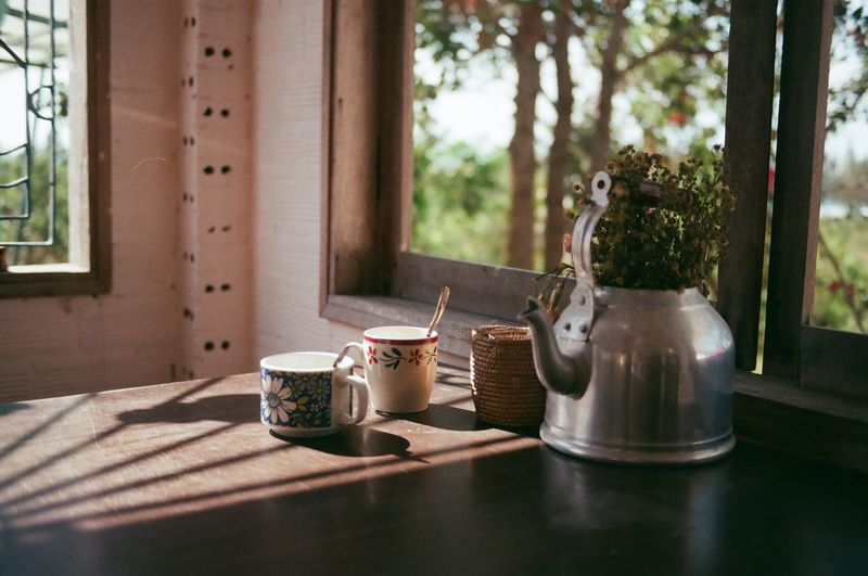 Tea cup on table at home