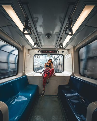 Portrait of woman sitting in train