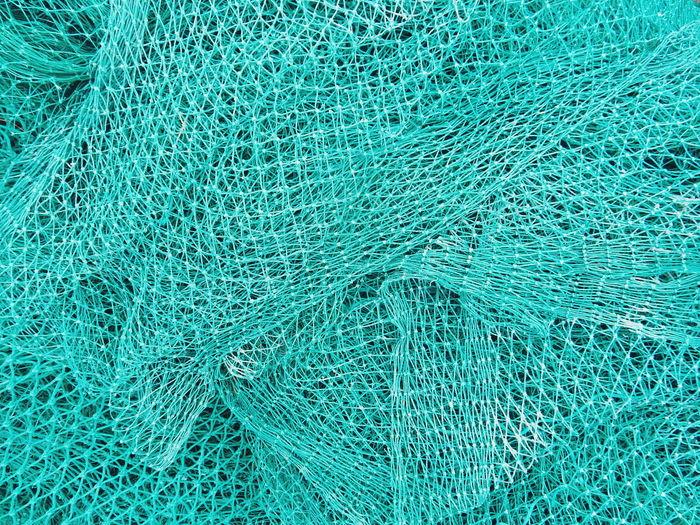 Full Frame Shot Of Blue Fishing Net