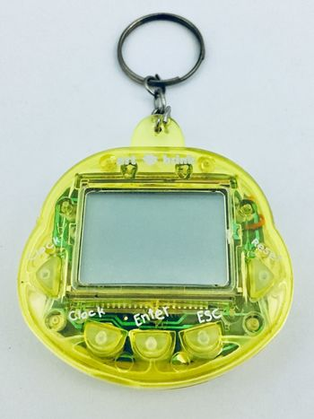 Tamagotchi Virtual Pet Videogame  Video Game  Electronic Game Retro Tamagotchi No People White Background Indoors  Close-up Day