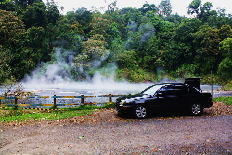 Kamojang Crater Beauty In Nature Car Crater Day Growth Land Vehicle Nature No People Outdoors Smoke - Physical Structure Transportation Tree Volcano Water