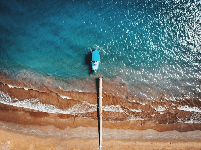 Lonely Boat waiting for its fisherman EyeEmNewHere Mediterranean  Sea Boat Fishing Fisherman Pier Dji Air Mavic Above View Nature Contrast Fishman Summer Hot Sunny Blue Aqua Droneshot Water Sea Sky Sand Shore Beach Coast Ocean Wave First Eyeem Photo