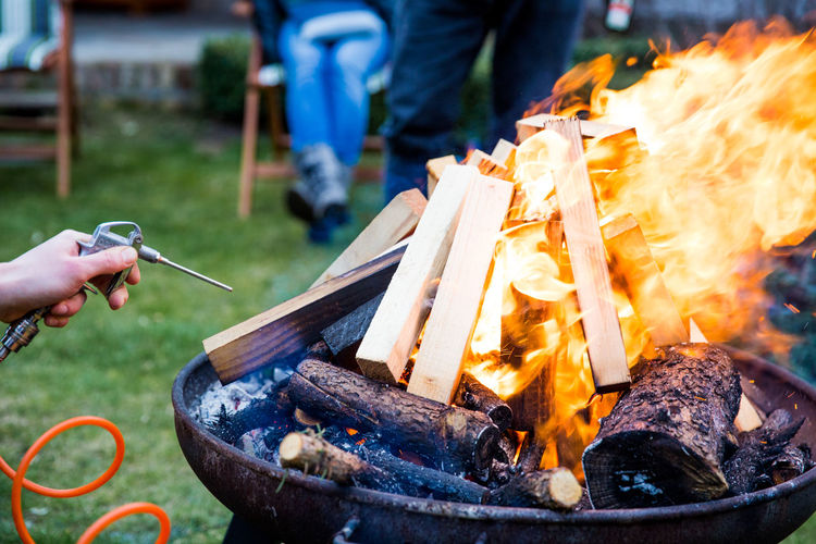 making fire like a pro // Accelerant Air Blowing Burn Burning Campfire Fan Fire Fire Bowl Flames Flames & Fire Focus On Foreground Garden Heat Heat - Temperature Pressure Pro Wood