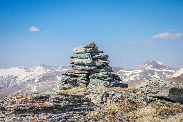 Stack of rock against sky during winter