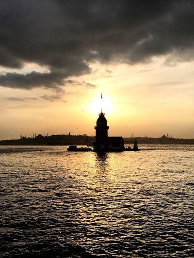 Sunset over Maiden Tower in Istanbul Sunset Kiz Kulesi Maiden Tower Istanbul Cloud - Sky Architecture Waterfront Sky Built Structure No People Building Exterior Nature Travel Destinations Outdoors Nautical Vessel Transportation Beauty In Nature Day Mobility In Mega Cities Mobility In Mega Cities