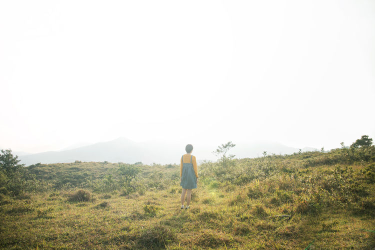 Shorts Looking At View Outdoors Landscape Field Walking Tranquil Scene Copy Space Tranquility Lifestyles Casual Clothing Scenics - Nature Beauty In Nature Full Length Real People Nature Leisure Activity Land Plant Sky One Person Rear View Clear Sky Grass