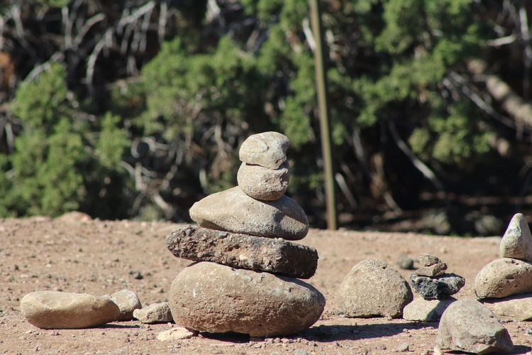 Solid Focus On Foreground Rock No People Stone - Object Balance Nature Stack Day Rock - Object Art And Craft Land Representation Stone Creativity Close-up Human Representation Zen-like Outdoors Sunlight Pebble
