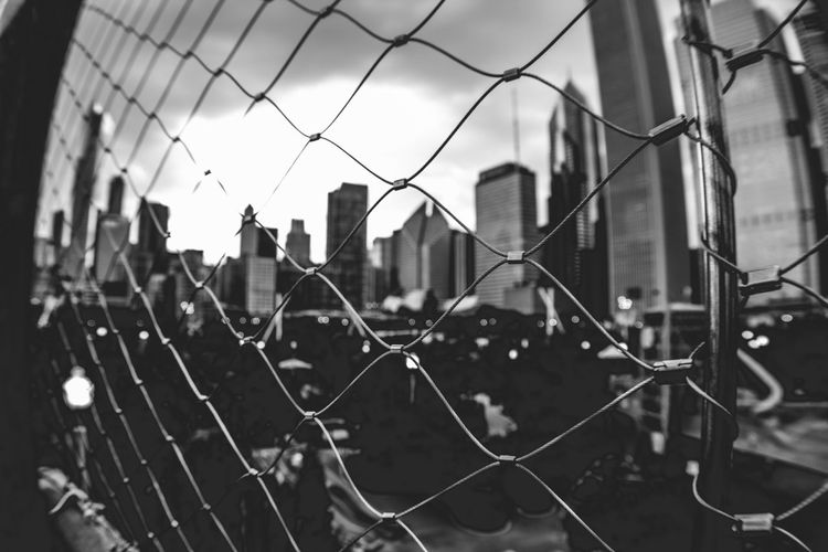 Chicago through the fences B&W Architecture Blackandwhite Building Exterior Chainlink Fence City Close-up Court Day Focus On Foreground Metal No People Outdoors Protection Safety Sky Soccer Field