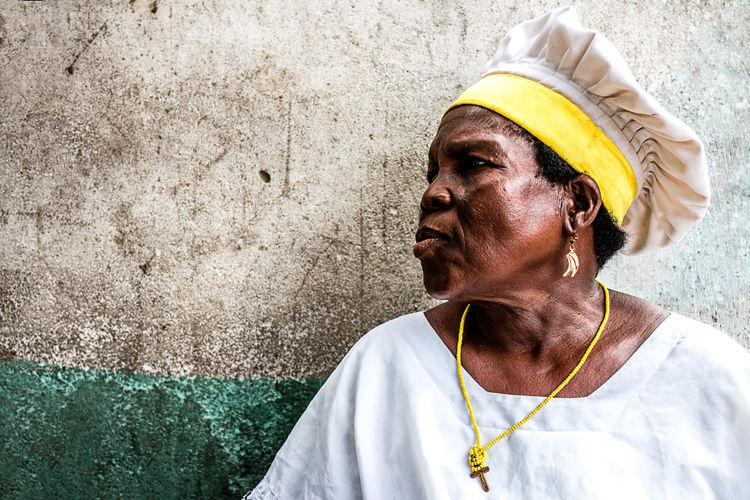 woman observing the voodoo ceremony outside the convent | Ganvié, Southern, Benin Benin Colors Documentary Photography Travel Africa Ceremony Documentary Portrait Potrait Of Woman Religion Voodoo