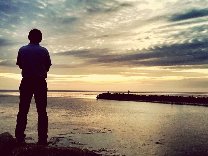 Sky Water Full Length Sunset Real People Rear View Cloud - Sky One Person Beauty In Nature Outdoors Scenics Leisure Activity Standing Sea Silhouette Nautical Vessel Nature Tranquil Scene Tranquility Men