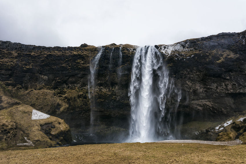 Landscape in Iceland Beauty In Nature Day Environment Flowing Flowing Water Idyllic Majestic Motion Mountain Nature No People Non-urban Scene Outdoors Power In Nature Rock - Object Rock Formation Scenics Sky Splashing Tourism Tranquil Scene Tranquility Travel Destinations Water Waterfall