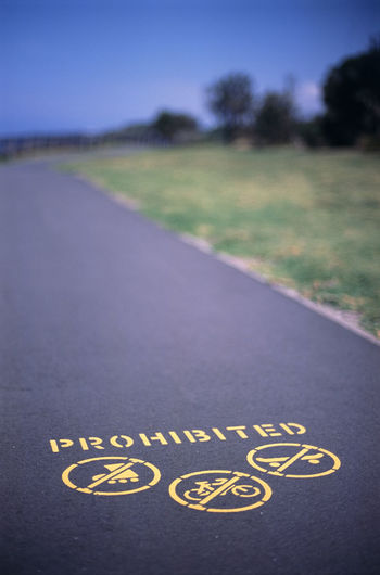 stenciled sign, skating and cycling prohibited Bicycle Blue Cycle Cycling Inlinerolerblade No Cyclepath No Skating Outdoors Sign Sign Skate Skateboard Stencil Sunny Symbol Tarmac Yellow