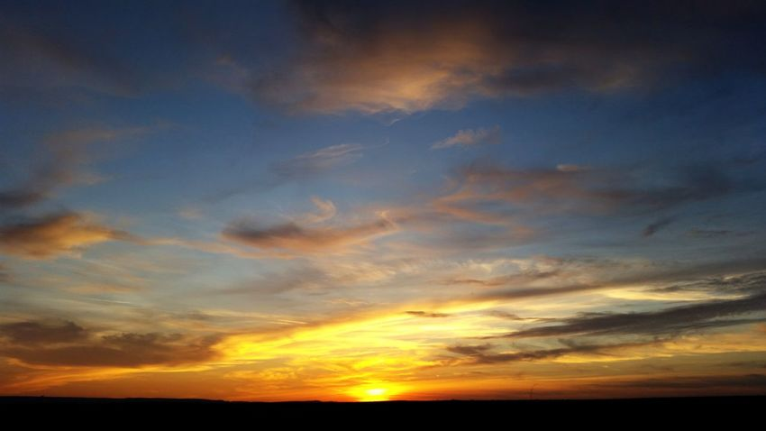 Sunset Saturated Color Sunset Beauty Water Multi Colored Backgrounds Blue Yellow Horizon Silhouette First Eyeem Photo