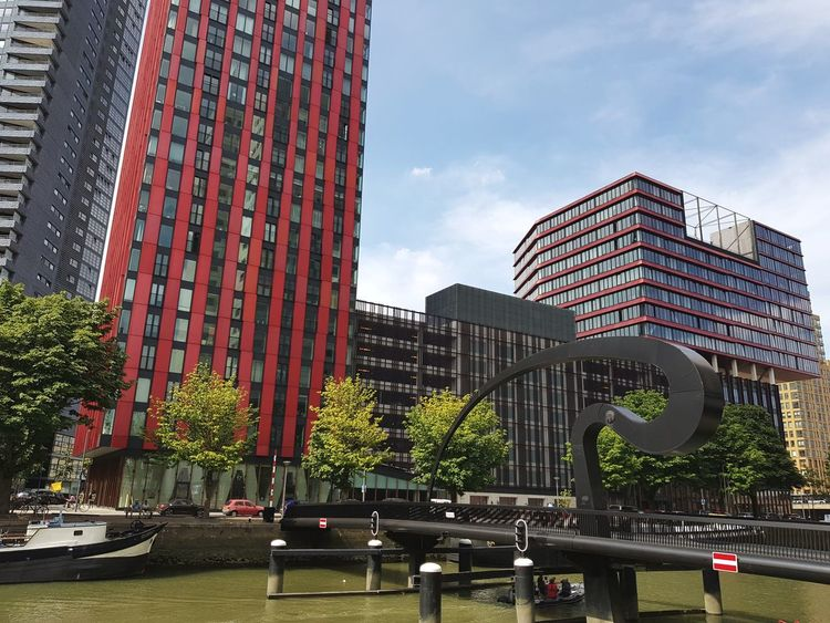 Architecture Architectural Detail Skyscraper Beautiful Day Modern City Built Structure Building Exterior Cityscape Bridge - Man Made Structure Travel Destinations Taking Pictures Taking Photos Architecture_collection Eye4photography  Dutch Cities Rotterdam Architecture Dutch Architecture Bridge Red Urban Skyline Wijnhaven Red Apple Building Arch