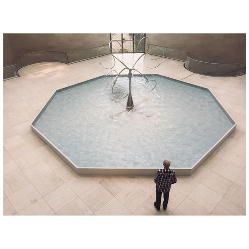 High angle view of person standing by swimming pool