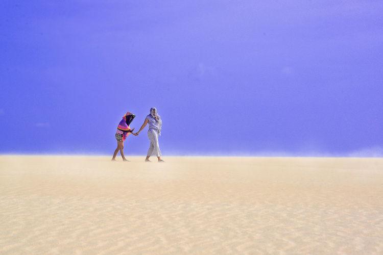 fun summer at desert Summer Road Tripping Sand Dune Full Length Desert Beach Men Sand Arid Climate Blue Togetherness Sky