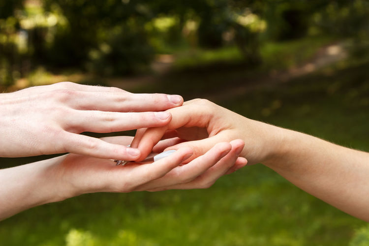 Close-up of people hands against blurred background