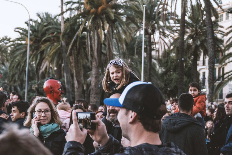 People photographing on palm trees