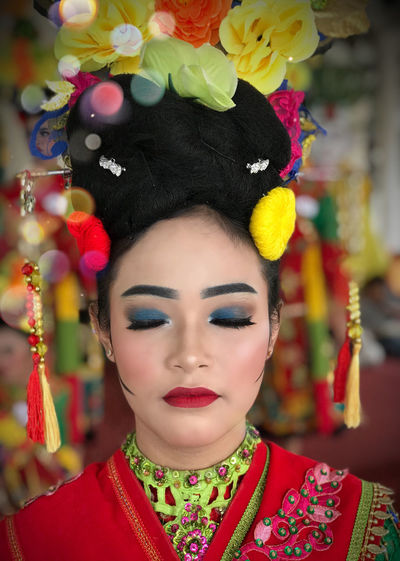 Close-up of young woman with make-up