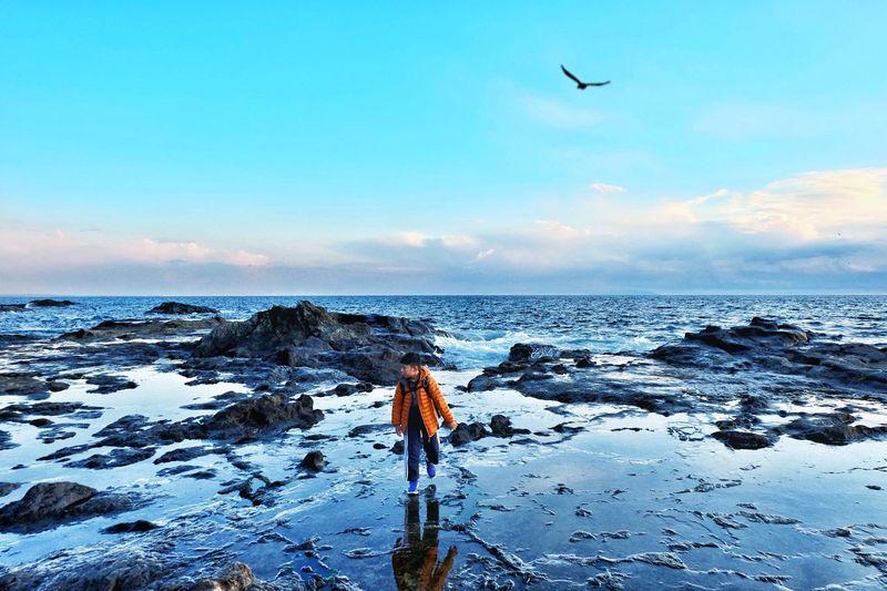 Full length of man standing in sea
