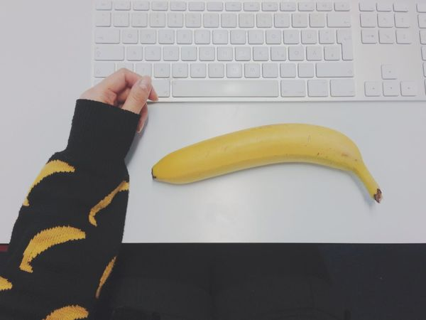Banana Fans//:D Banana Close-up Creativity Food Freshness Fruit Funny Hand High Angle View Human Body Part Human Finger Indoors  Interior Views Keyboard Lifestyles Me Person Sweater Table White Yellow Working Enjoy The New Normal Fine Art Photography Embrace Urban Life Paint The Town Yellow