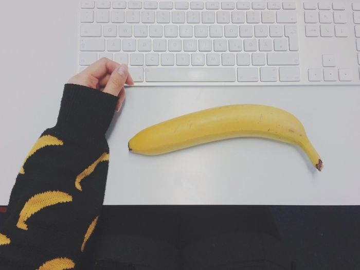 Close-Up High Angle View Of Keyboard And Banana