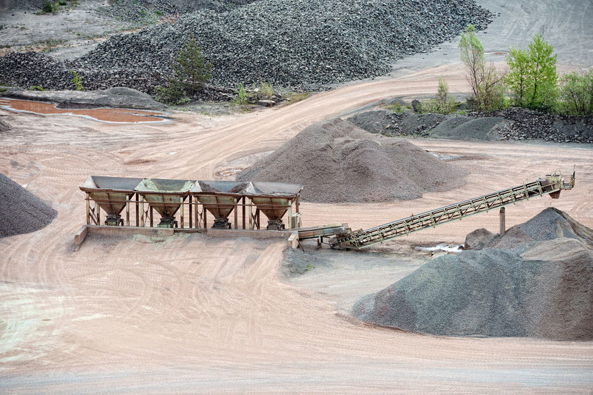 stone crusher in a quarry. mining industry Steinbrecher Stone Crusher Conveyor Belt Loading Mine Minerals Mining Quarry Quarry Rock Stonepit Rocks Steinbruch Construction Material Construction Materials Production Stone Pit Transportation Surface Mine
