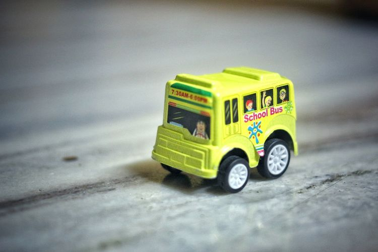 Close-up of toy car on street