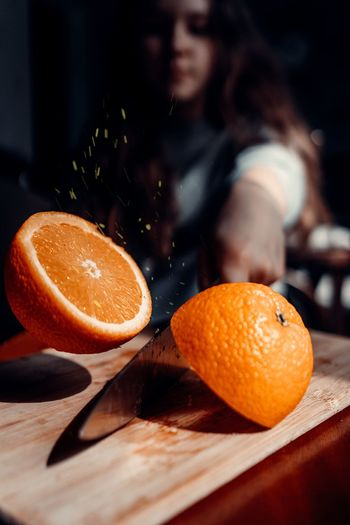 Orange fruit on cutting board
