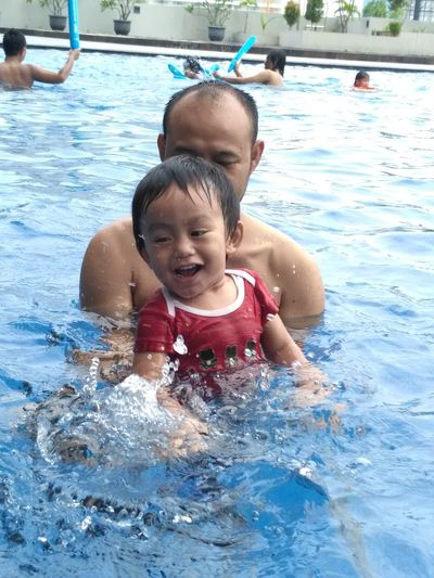 father n son Babyboy Fatherandson Fatherandsonmoments Jakarta Indonesia Water Slide Water Swimming Child Swimming Pool Childhood Togetherness Smiling Boys Happiness