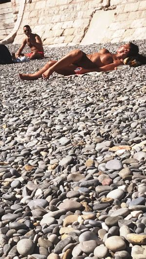 He catches me picturing her Nice, France Cannes The French Rivera France Nice Sand Vacations Relaxation Beach Pebble People Adults Only Only Women Adult Rock - Object Lying Down Toplesswoman Nakedboobs